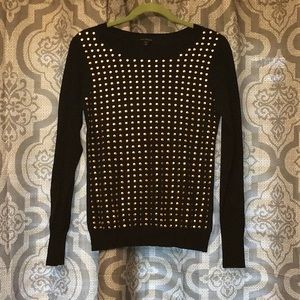 L/S sweater with gold embellishment on front.